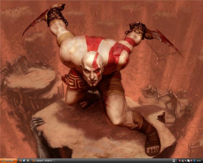 Kratos ao fundo e o tema Zune instalado no XP