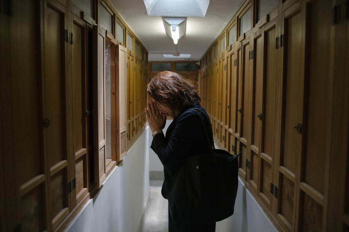 Mulher fazendo oração