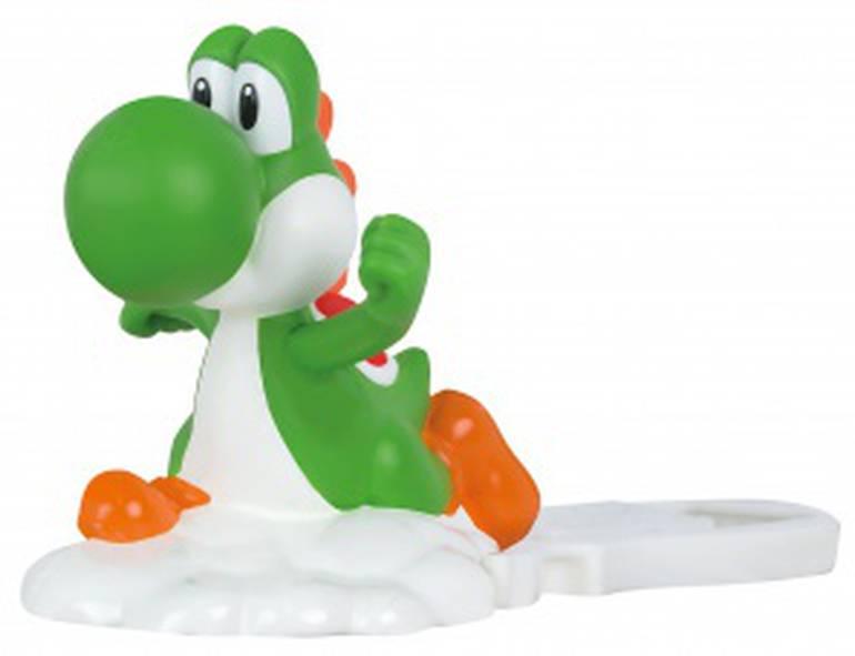 Como lançar um Yoshi? Aqui, você coloca a figura do Yoshi no lançador e aperta o botão para que ele seja disparado para a frente