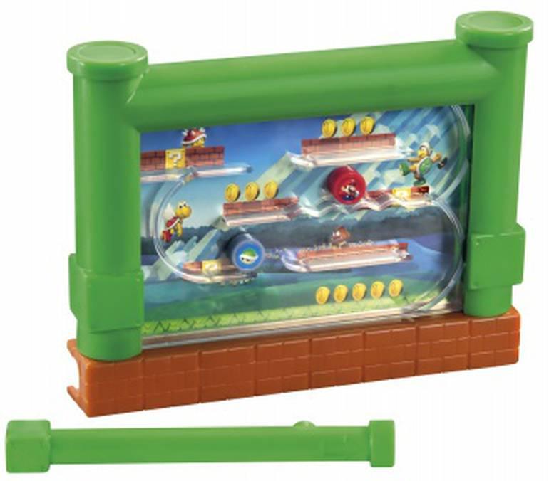 Com um imã atrás do brinquedo, você precisa levar as figuras de Mario e do casco de Koopa para o final do caminho em segurança