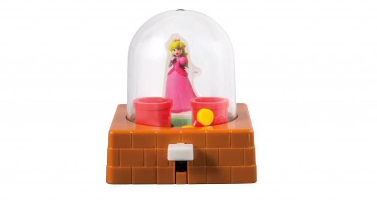 Aquaplay da Princesa Peach: você precisa apertar o botão e os corações e estrelas saltarão lá dentro, e seu objetivo é fazer eles caírem nos tubos