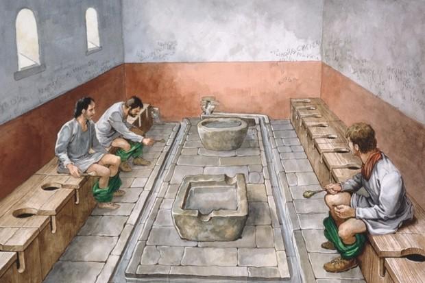 Imagem mostrando como era um banheiro público romano (Fonte: Reprodução)