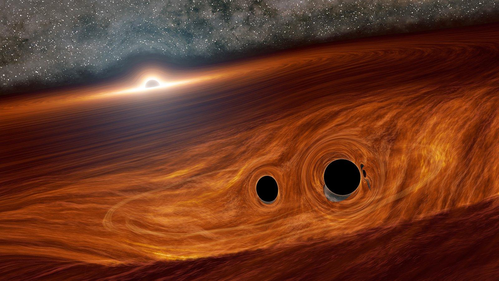 Conceito visual de um buraco negro supermassivo e seu disco circundante de gás. Embutidos neste disco estão dois buracos negros menores em órbita.