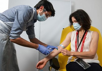Woman receives the ChAdOx1 vaccine candidate, from the University of Oxford, in Phase 2 of the clinical tests.