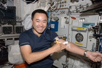 Astronaut Akihiko Hoshide, after collecting blood on board the ISS.