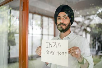 Photo by Ketut Subiyanto, asking Indians to stay at home.