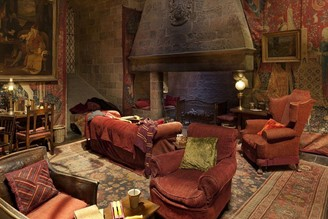 The Common Room is decorated in the colors of the house: red and gold.