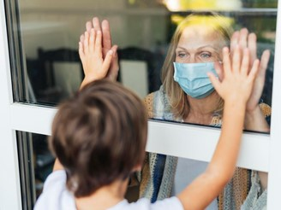 Woman greeting child