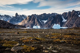 Researchers suggest that chunks of rock with a high mercury content are dragged along with ice in the Greenland region.