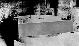 Photograph of the original apparatus from Michelson and Morley's interferometric experiment, mounted on a stone slab that floats in an annular mercury chute
